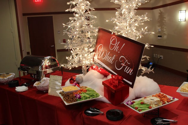 Table with Christmas decorations and vegetable platter