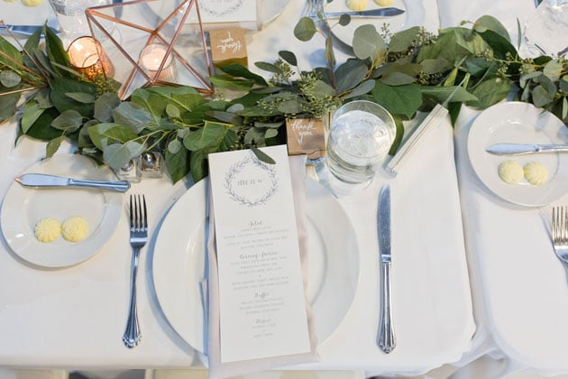Table Setting with Menu Card and Greenery Centerpiece