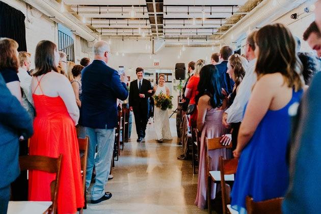 Brides Walks Down Isle at Firehouse Chicago Wedding