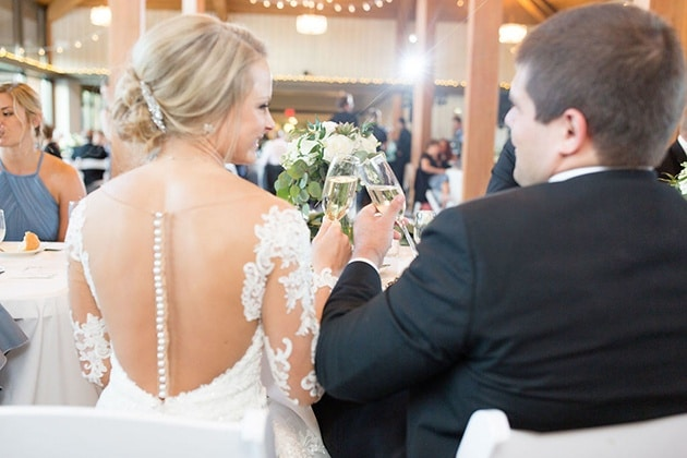 Bride and Groom Cheers at Wedding