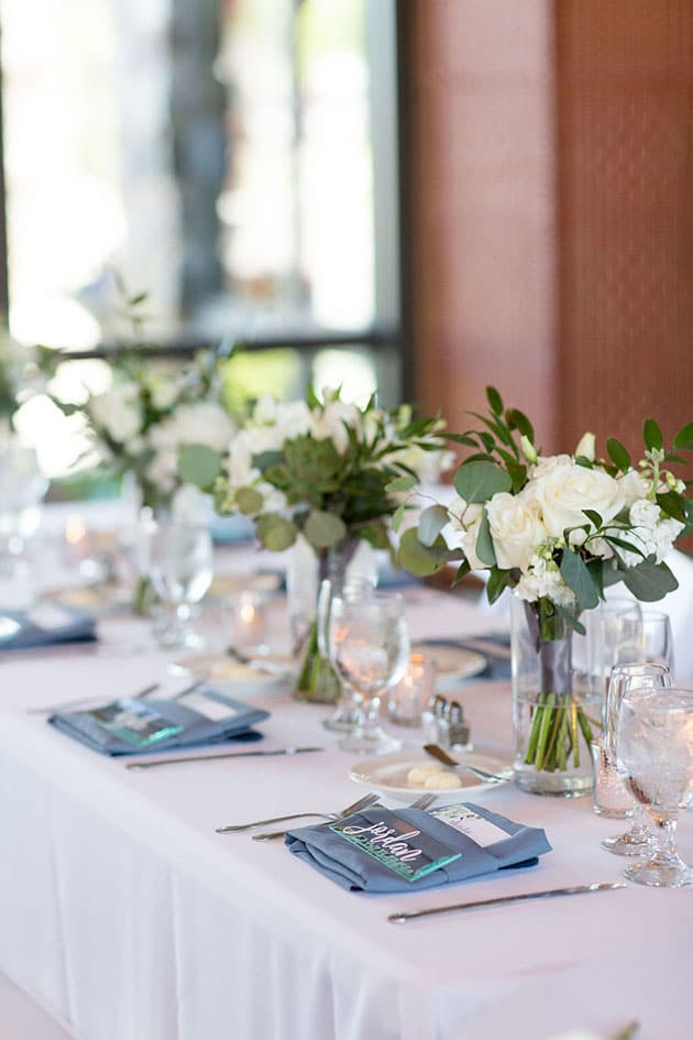 Table Setting at Wedding with Blues and White Flowers