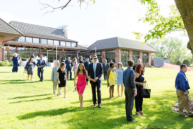 Guests Arrive for Ceremony at Oak Brook Bath and Tennis Wedding