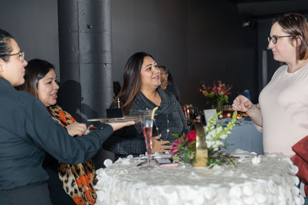 Guests Enjoying Passed Appetizers from Tasty Catering