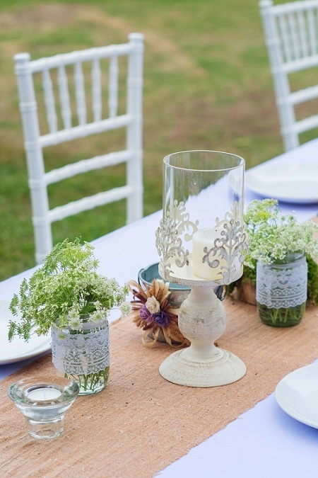 Wedding dining table outdoor with china and flowers