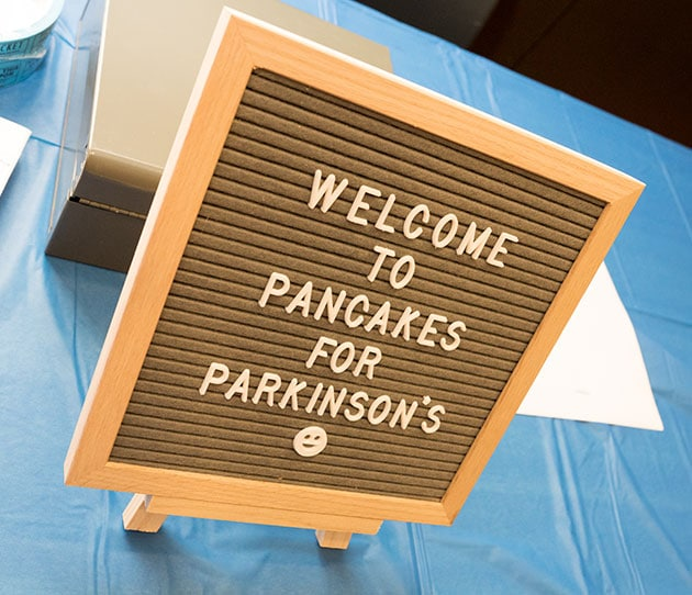 """Sign saying """"Welcome to Pancakes for Pakinson's"""""""