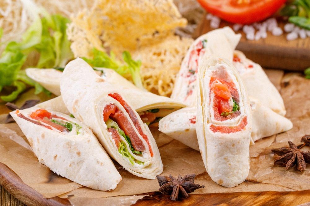 Mini lunch wraps on a cutting board