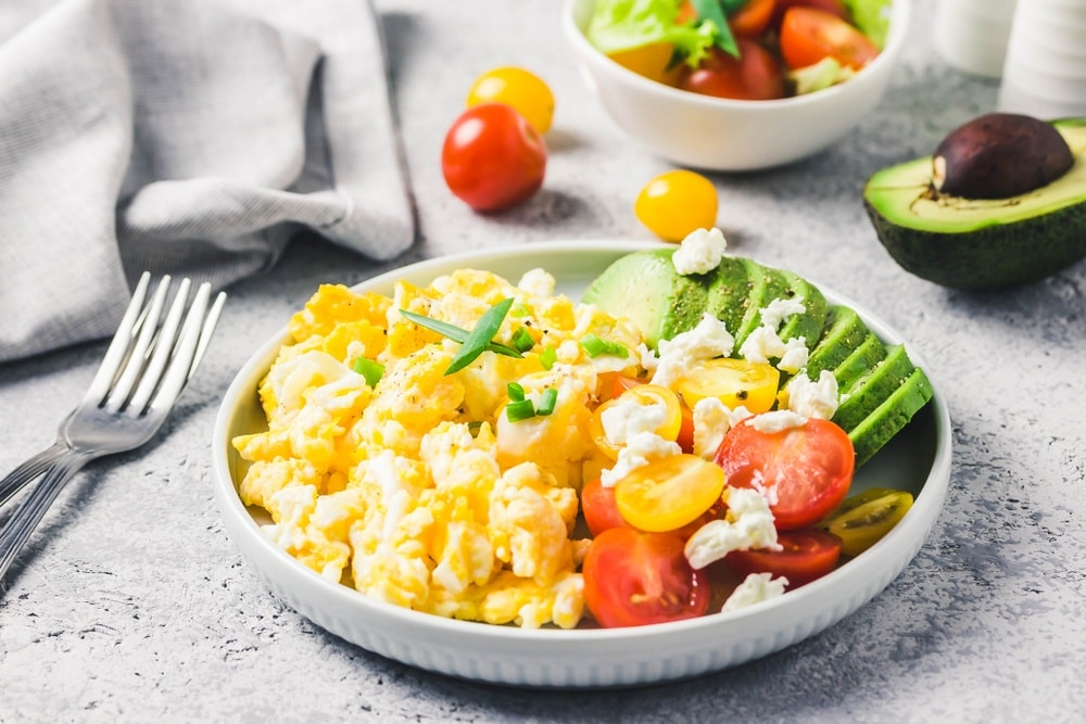 Scrambled eggs with a side of avocado and other healthy breakfast foods