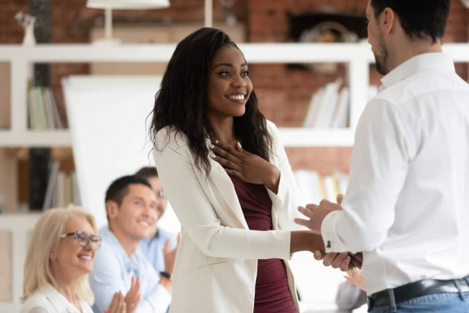 Employee being recognized by her boss at work