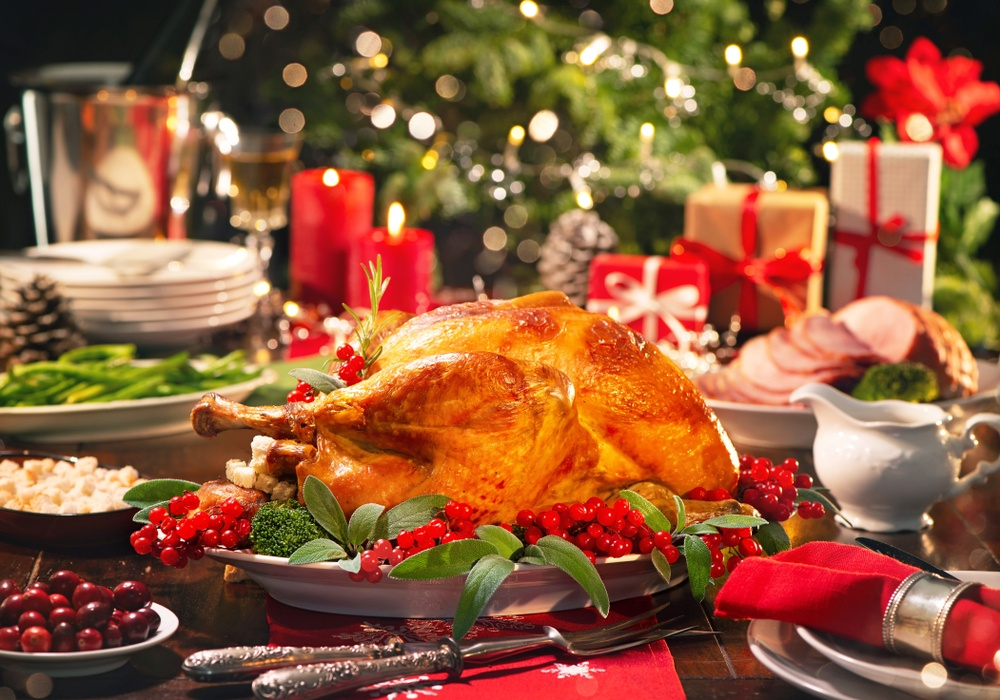Holiday dinner on a table with a roasted turkey