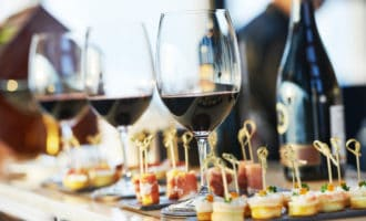Wine glasses and small appetizers on a counter