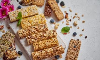 Granola bars on a white serving platter