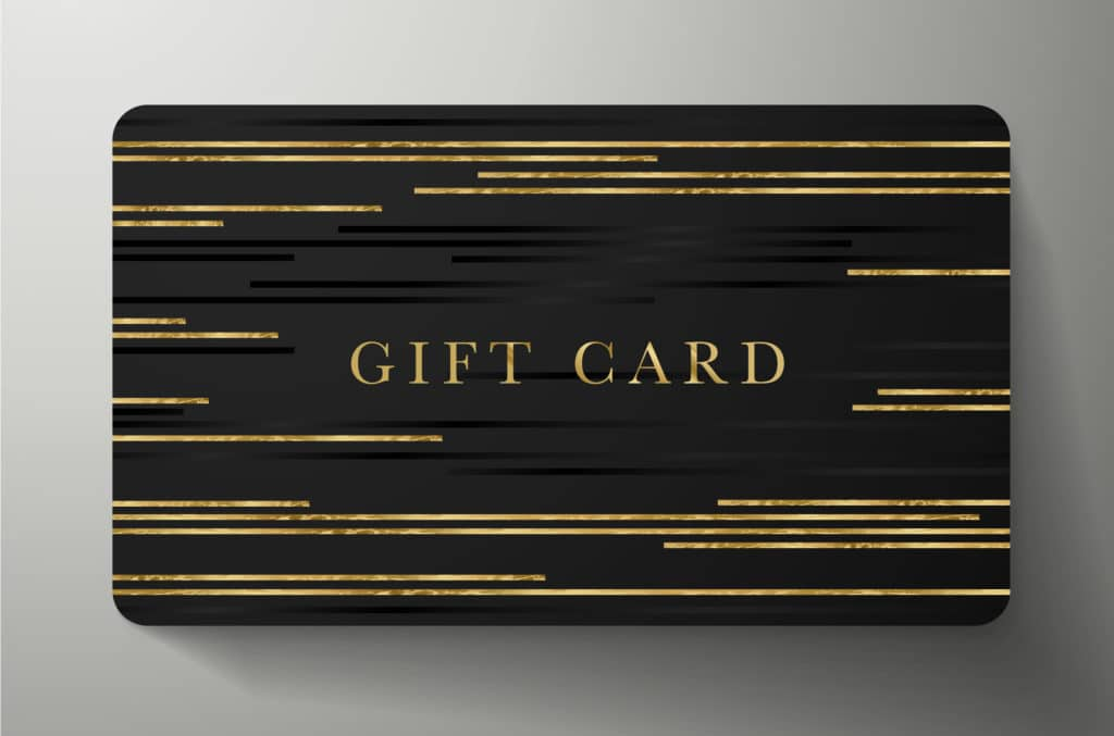 Black rectangular gift card with gift card written in gold