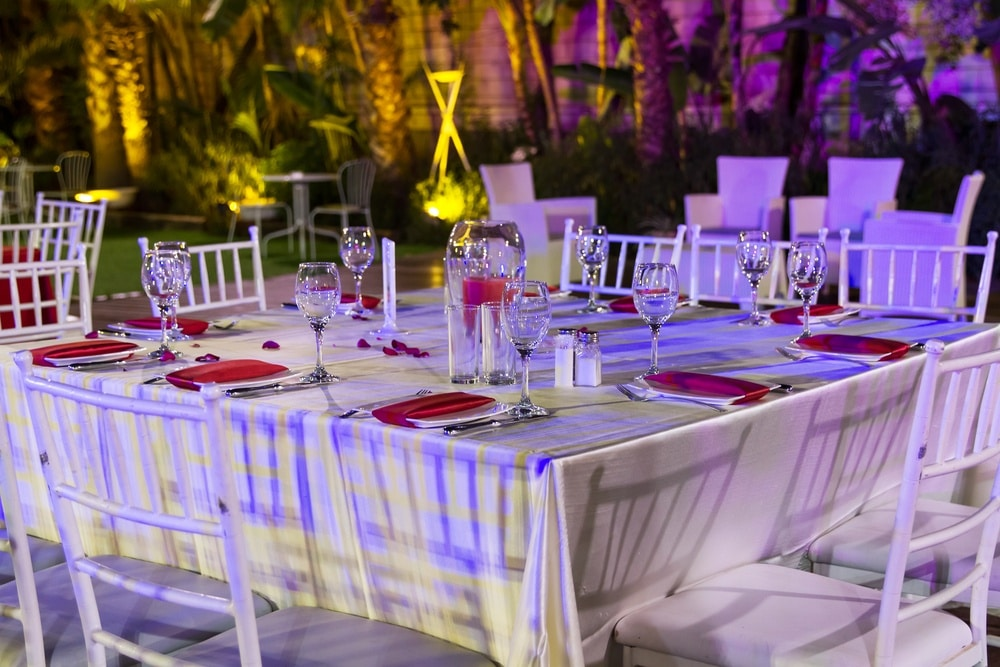 Square table set with chairs for a wedding