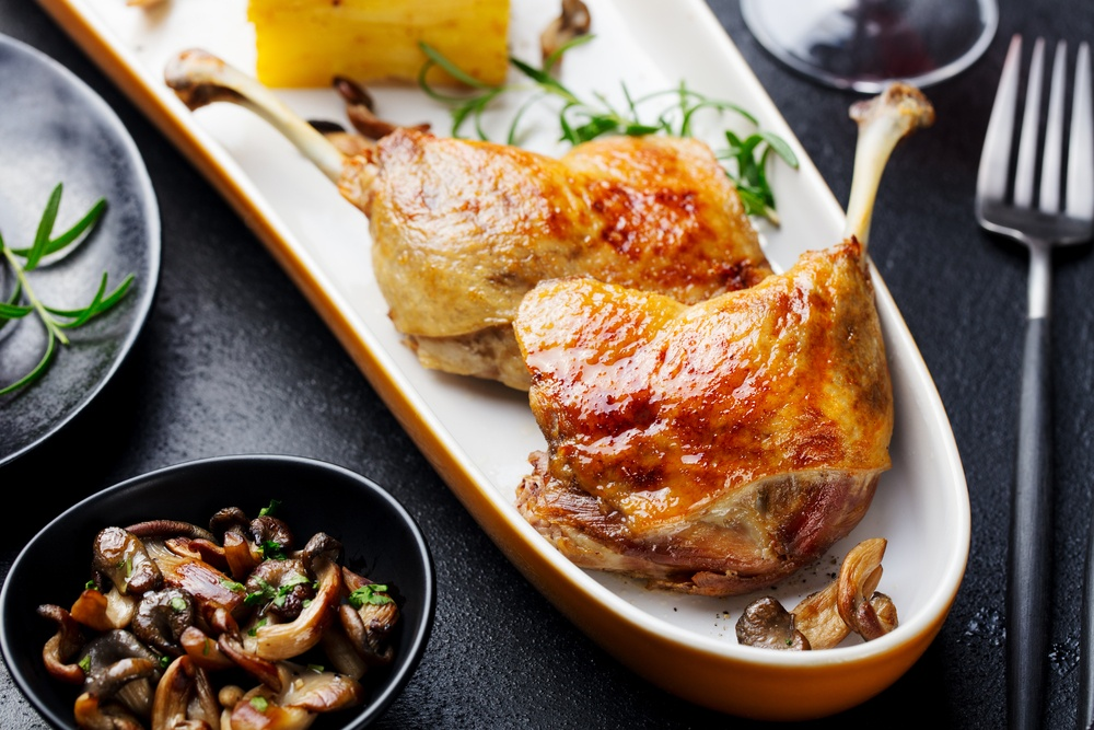 Duck confit and mushrooms on a platter
