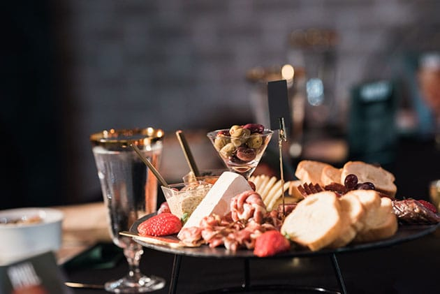 Charcuterie Board Centerpieces Replace Flowers at Every Table