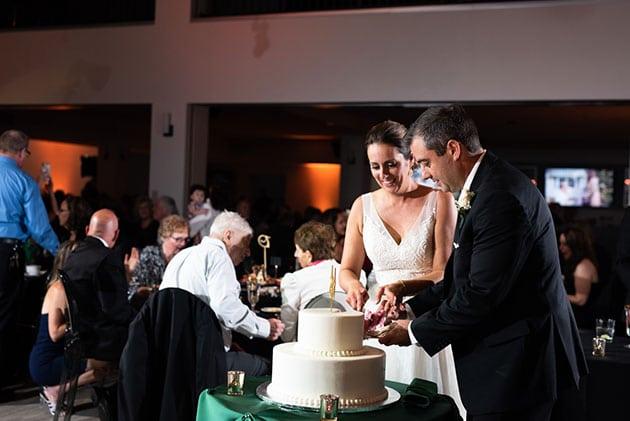 Bride and Groom Cut Cake at Loft 21 Wedding